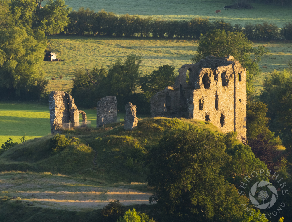 Sunrise and shadows at Clun Castle
