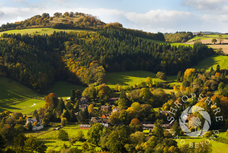 The village of Hopesay nestles beneath Burrow Hill iron age hill fort in autumn, near Craven Arms, Shropshire, England.