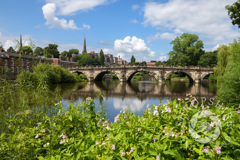 Summer sunshine on English Bridge over the River Severn in Shrewsbury, Shropshire.