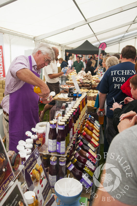 Sauces for sale in the marquee at Ludlow Food Festival, Shropshire, England.