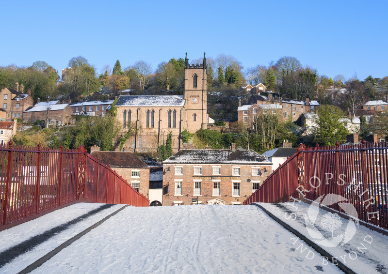 Snow on the Iron Bridge with St Luke's Church, Ironbridge, Shropshire.