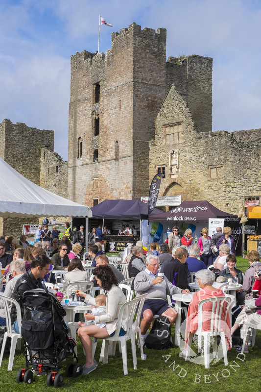 Visitors enjoy the sunshine in the grounds of Ludlow Castle, during the 2016 Ludlow Food Festival, Shropshire.