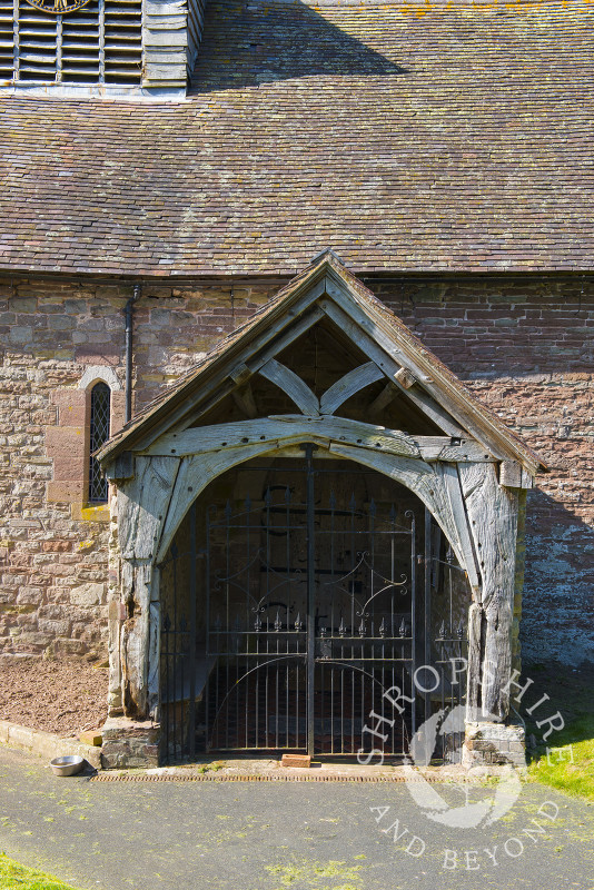The entrance to the 13th century Church of St Michael and All Angels at Stanton Long, Shropshire.
