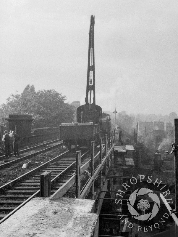 A crane dismantling the old railway bridge, Shifnal, Shropshire, 1953.