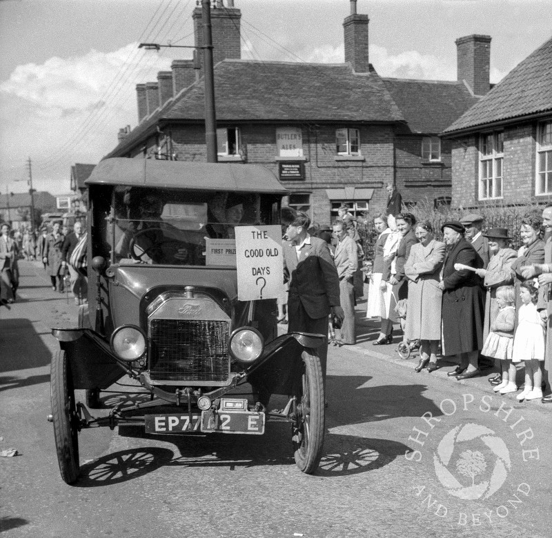 A float passes the Beehive public house in Shifnal, Shropshire, during the town's carnival procession in the 1950s.