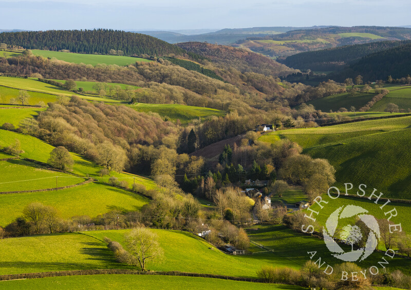 The village of Obley in the Clun Valley, seen from Black Hill, Shropshire.