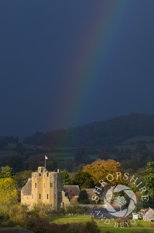 Autumn sunshine and rainbow at Stokesay Castle, Shropshire.