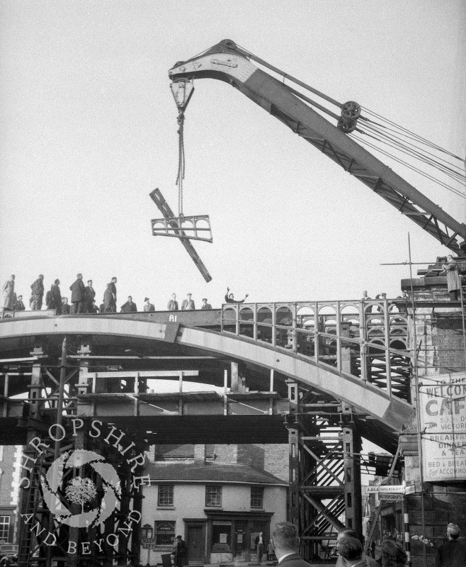 A crane lifting parts of the old railway bridge, Shifnal, Shropshire, 1953.