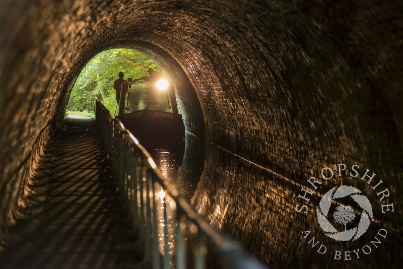 A canal boat passing through Ellesmere Tunnel on the Llangollen Canal in Shropshire.