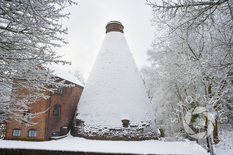 Snow covered bottle kiln at the Coalport China Museum, one of the Ironbridge Gorge Museums, at Coalport, Shropshire.