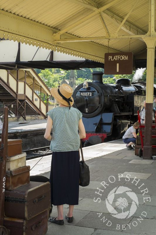A passenger waiting on the platform at Llangollen Railway Station, Wales.