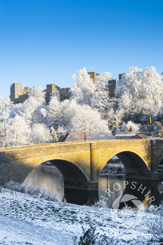 Dinham Bridge and Ludlow Castle under a layer of hoar frost at Ludlow, Shropshire, England.