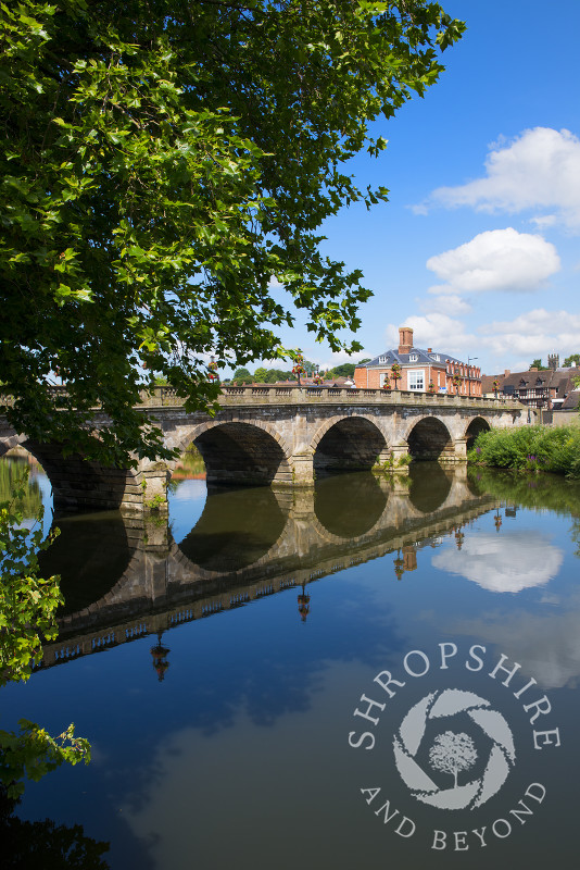 Welsh Bridge reflected in the River Severn at Shrewsbury, Shropshire, England.