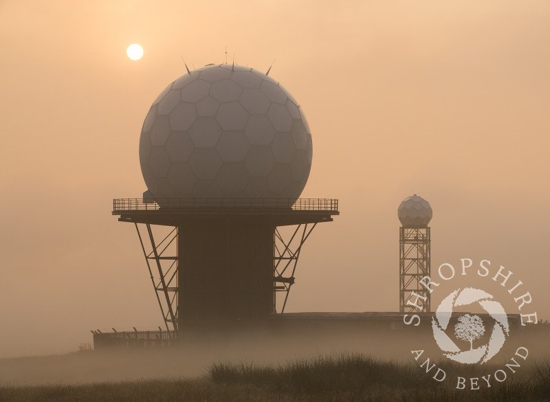 Early morning mist surrounds the radar domes on Titterstone Clee Hill, Shropshire.