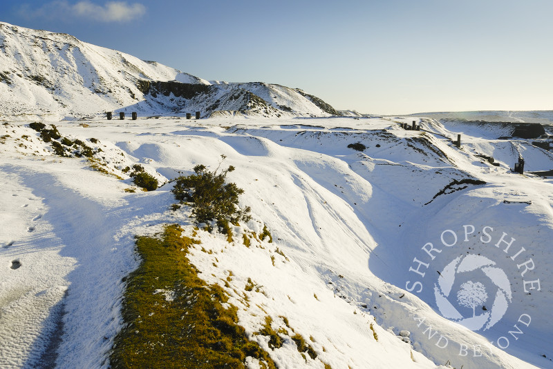 Sunlight on winter snow covering Titterstone Clee Hill, Shropshire, England.