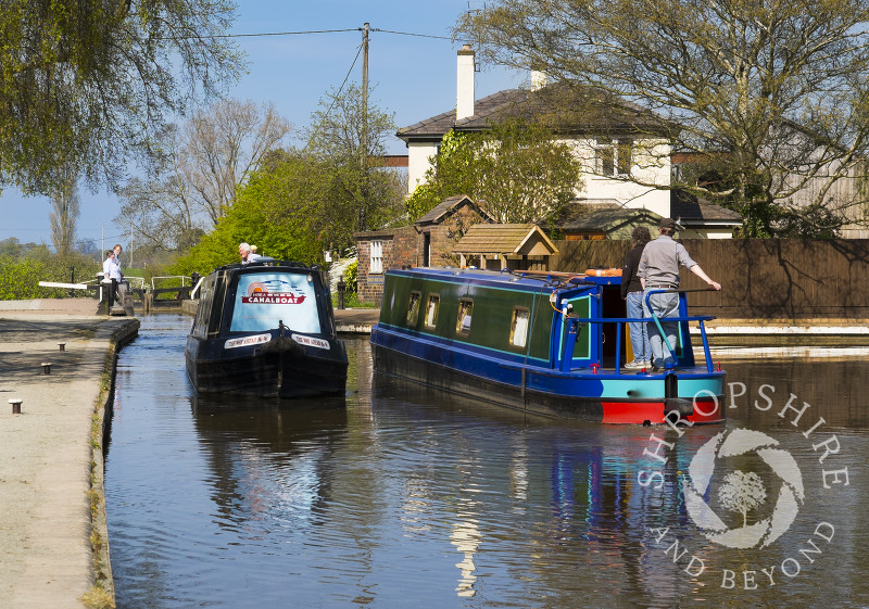 Canal boats at Grindley Brook locks, near Whitchurch, Shropshire, England.