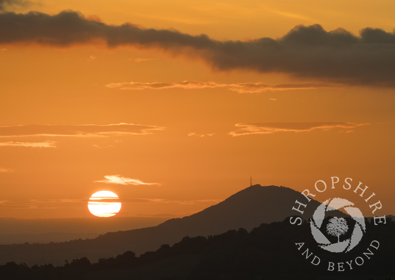 The Wrekin at sunrise, seen from the Lawley, near Church Stretton, Shropshire.