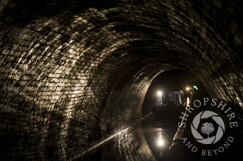 A narrowboat passing through Darkie Tunnel towards Chirk Aqueduct, Wrexham, Wales.