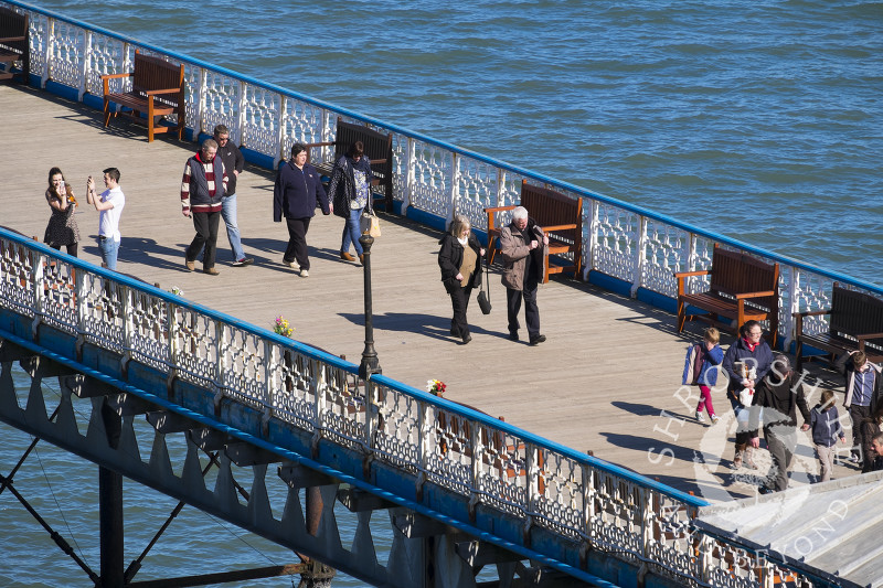 Visitors enjoy the sunshine on Llandudno Pier, north Wales.