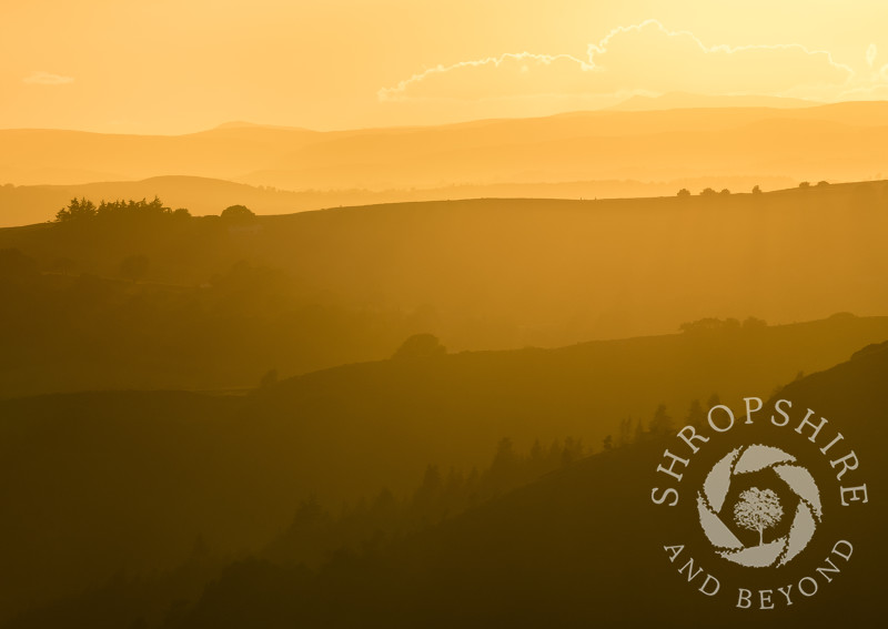 Sunset over the Shropshire and Powys border, seen from Linley Hill, Shropshire.