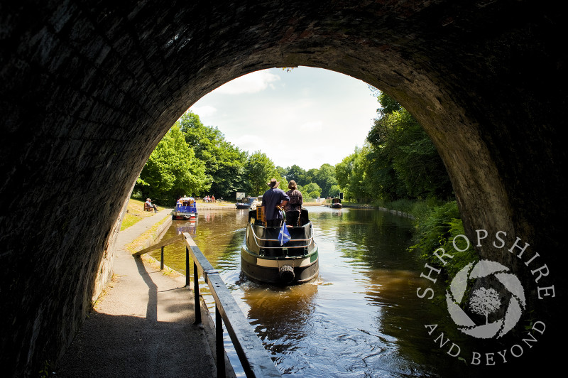 A canal boat leaving Darkie Tunnel at Chirk, Wrexham, Wales.