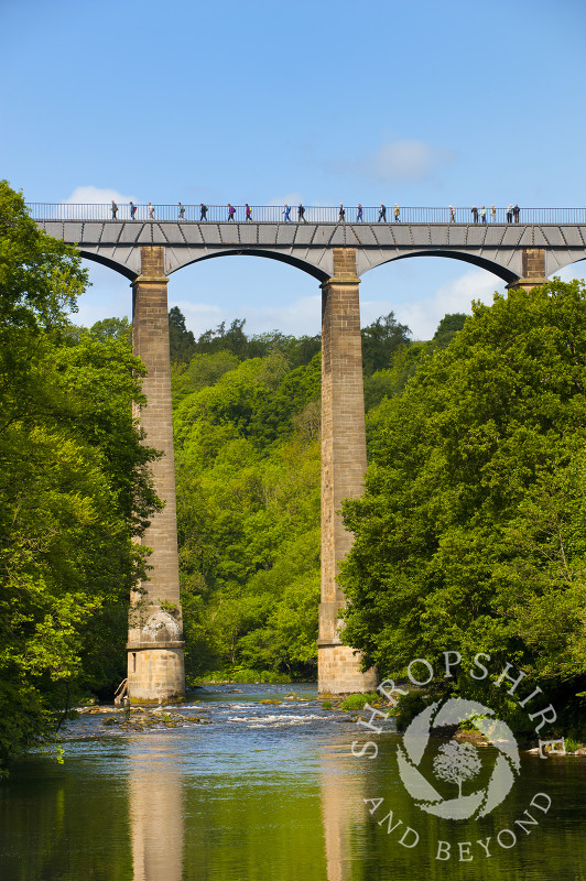People walking along Pontcysyllte Aqueduct, above the River Dee, Wales.