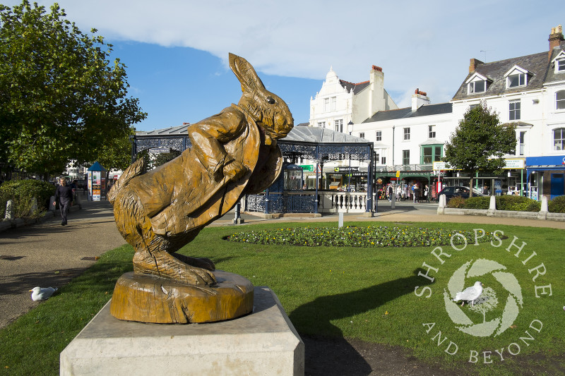 The White Rabbit wooden statue  celebrates the town's links to Alice In Wonderland author Lewis Carroll, Llandudno, Wales.