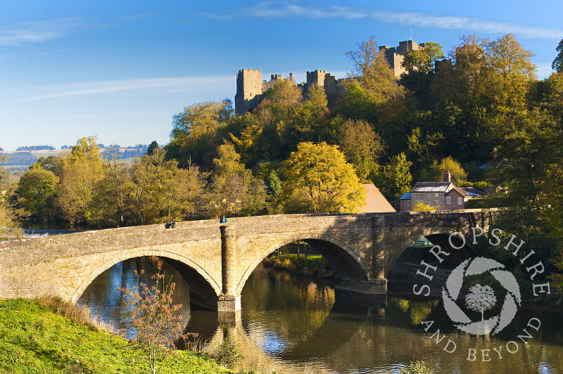 Dinham Bridge and Ludlow Castle in autumn reflected in the River Teme at Ludlow, Shropshire.