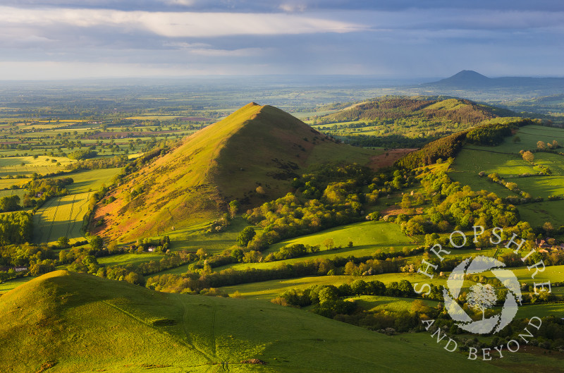Evening light on Caer Caradoc and the Lawley, Shropshire, with the Wrekin in the distance.