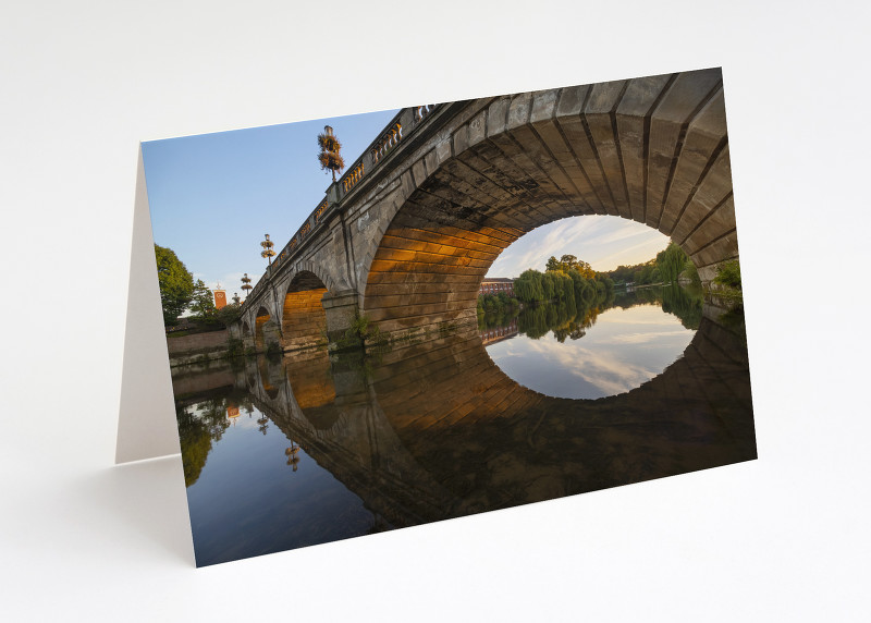 Welsh Bridge reflected in the River Severn at Shrewsbury, Shropshire.