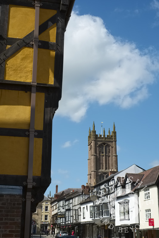 St Laurence's Church and a half-timbered building in Broad Street, Ludlow, Shropshire.