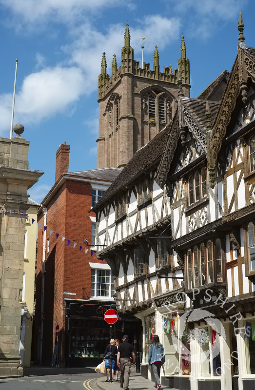 St Laurence's Church overlooks half-timbered buildings in Broad Street, Ludlow, Shropshire.