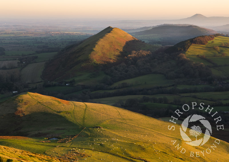 Winter sunrise on Caer Caradoc, near Church Stretton, with the Lawley and the Wrekin.