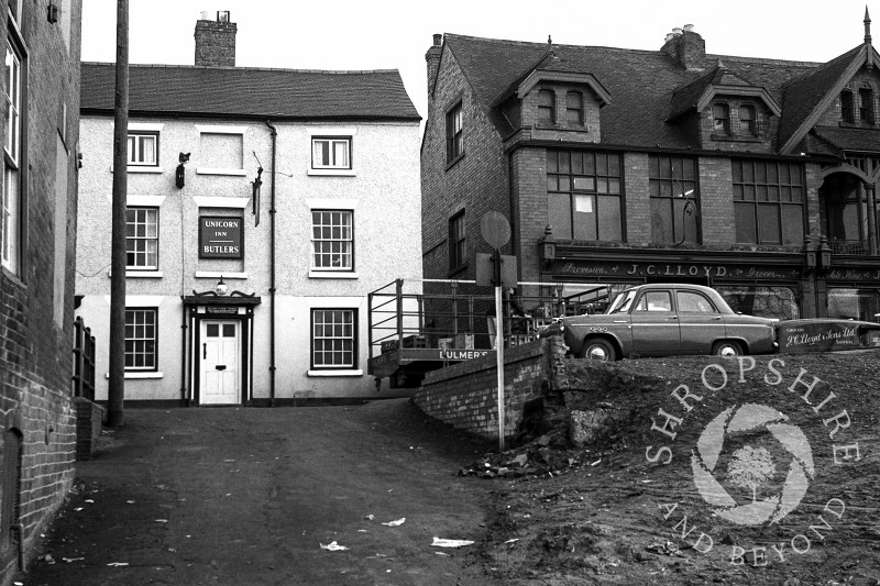 The Unicorn Inn and J C Lloyd grocer's shop in Park Street, Shifnal, Shropshire, in 1965.
