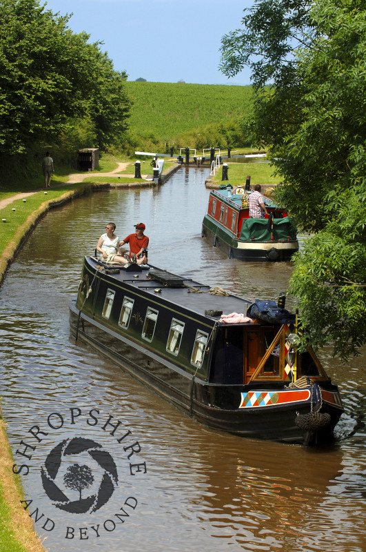 Canal boats on the Shropshire Union Canal at Tyrley Locks, near Market Drayton, Shropshire, England.