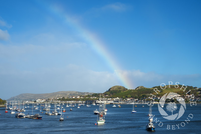 Rainbow over Conwy Bay, looking to Deganwy, Wales.