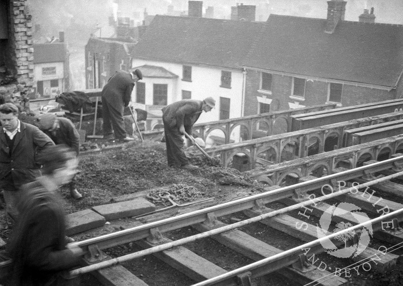 Workmen on the old railway bridge at Shifnal, Shropshire, 1953.