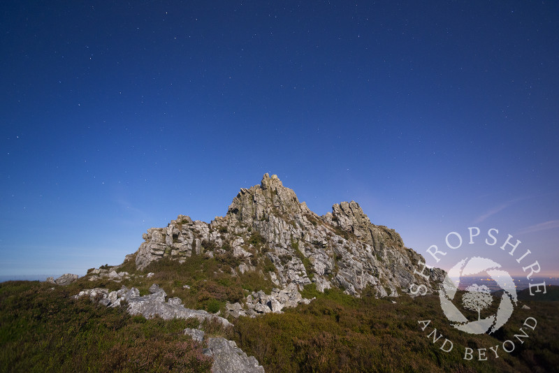 Moonlight illuminates the Devil's Chair rock formation on the Stiperstones, Shropshire. Overhead can be seen the Plough, part of the Ursa Major constellation.