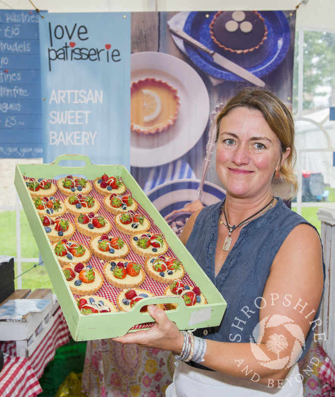 Tracey Dugan of Love Patisserie with a tray of bakes at the 2016 Ludlow Food Festival, Shropshire.