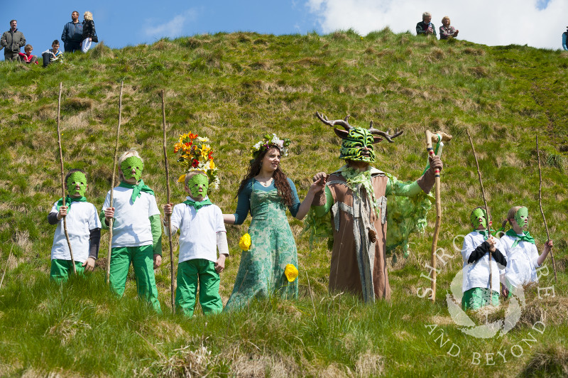 The May Queen and the Green Man with their attendants at the Clun Green Man Festival, Shropshire.