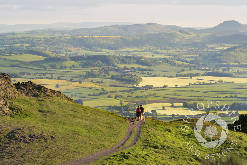 Walkers on the Wrekin enjoy a view of the Stretton Hills in Shropshire.