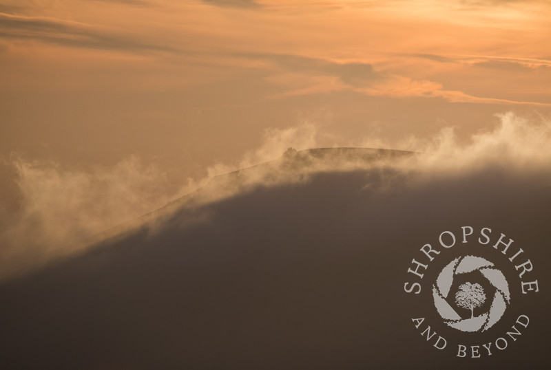 Mist rolls over Wilstone Hill, seen from the Long Mynd, Shropshire.