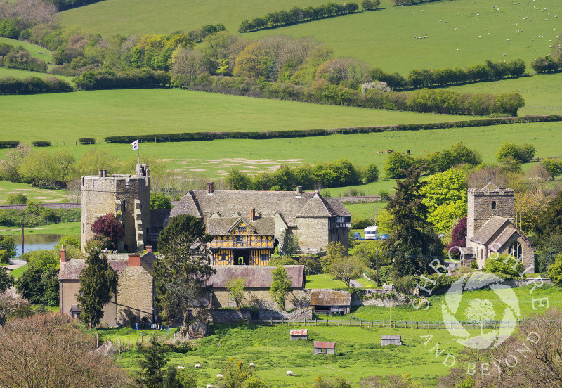Stokesay Castle and the church of St John the Baptist, near Craven Arms, Shropshire, seen from Nortoncamp Wood.