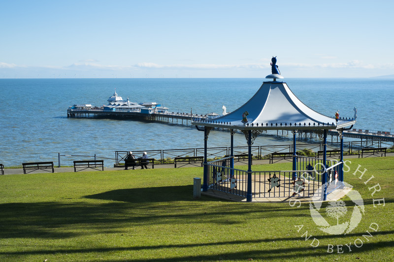 Happy Valley Gardens bandstand and Llandudno Pier, North Wales.