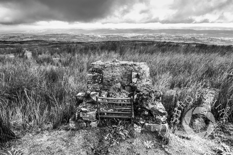 Ruined fireplace among the remains of mining on Brown Clee Hill, Shropshire, looking towards Corvedale, England.