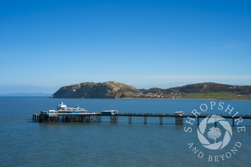 Blue sky over Llandudno Pier and the Little Orme, Llandudno, north Wales.