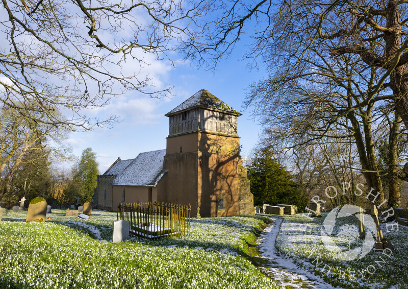 Snowdrops, snow and sunshine at St James' Church, Shipton, Shropshire.