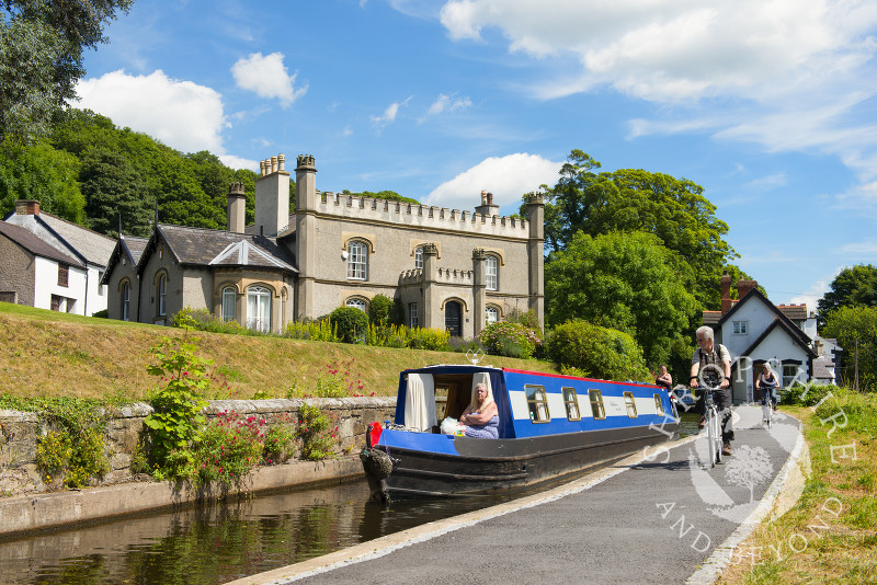 Cyclists on the towpath alongside the canal wharf in Llangollen, Denbighshire, Wales.