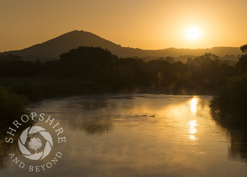 Sunrise over the River Severn and the Wrekin seen from Cressage Bridge, Shropshire.