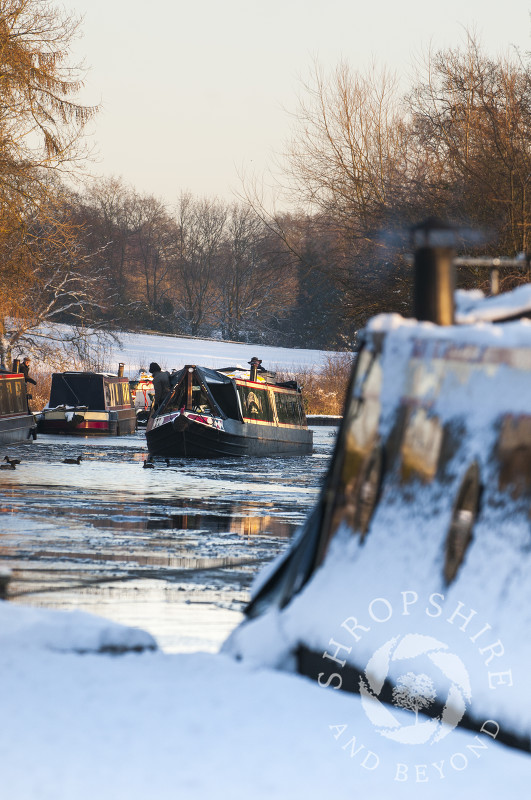 Winter ice and snow on the Llangollen Canal at Ellesmere, Shropshire, England.